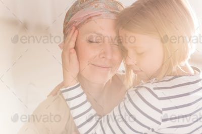 Small caring child embracing mother