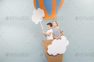 Boys taking a baloon flight