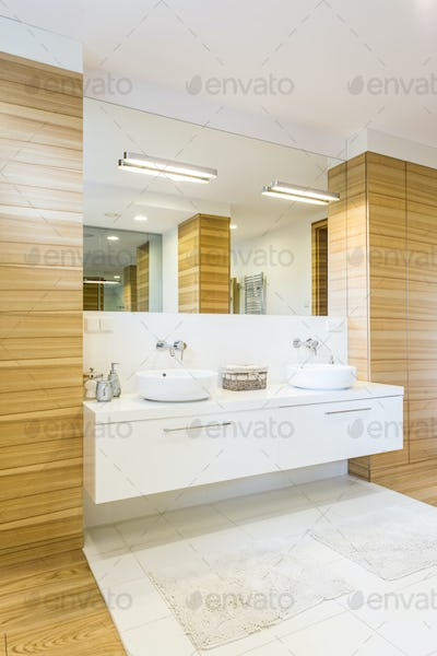 Wooden bathroom with mirror and sinks