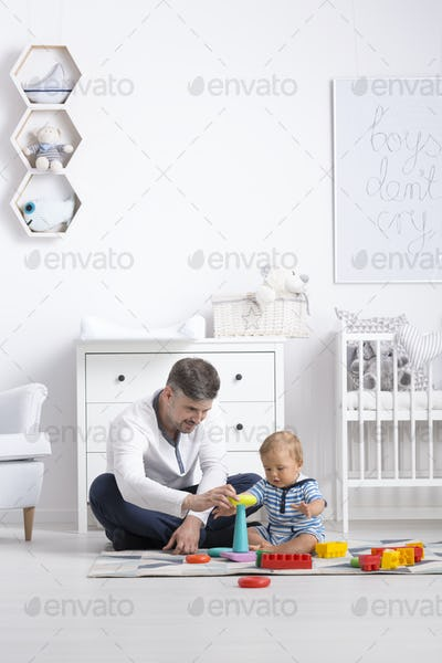 Father sitting with his baby