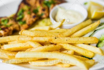 grilled meat with french fries close up
