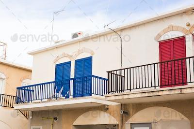balcony with red door and blue door
