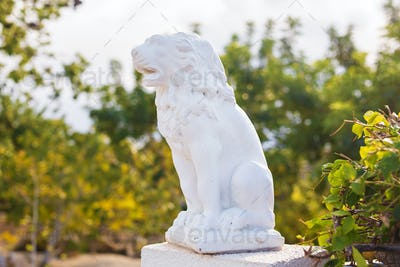White Marble Sculpture of a lion on pedestal