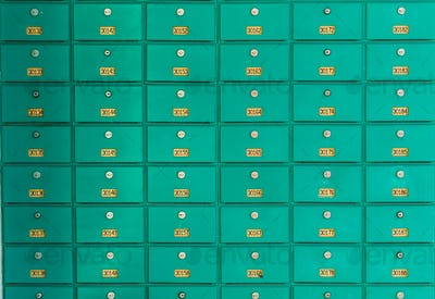 row of green mailboxs