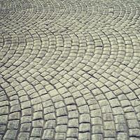 Vintage toned old cobblestone pavement background