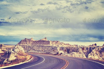 Vintage toned scenic road in Badlands National Park, USA.