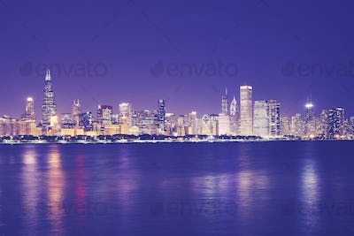 Vintage toned picture of Chicago city skyline at night.