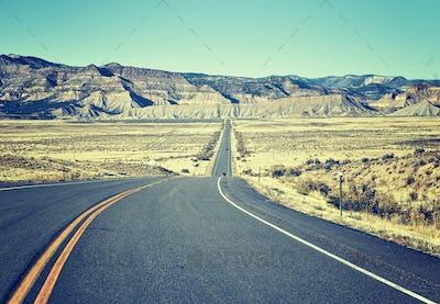 Retro old film stylized asphalt road, travel concept, USA