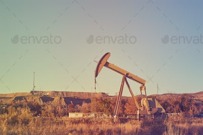 Retro color toned an old oil pump, industrial equipment.