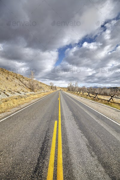 Rainy clouds over road in the Grand Teton National Park, Wyoming