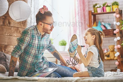 father and daughter play