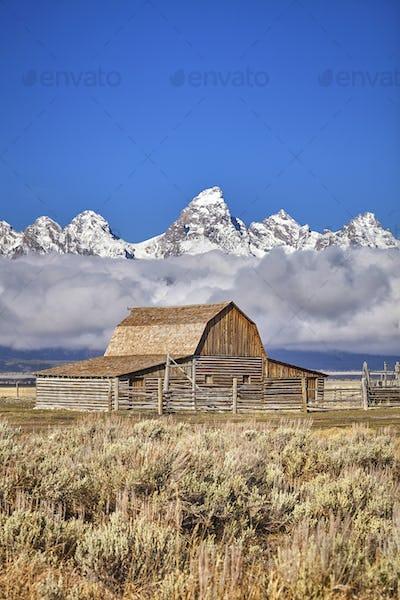 Teton mountain range with Moulton Barn in the Grand Teton Nation