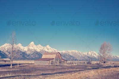 Retro stylized famous Grand Teton landscape, USA.