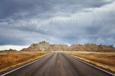 Scenic road in Badlands National Park, vacation background.