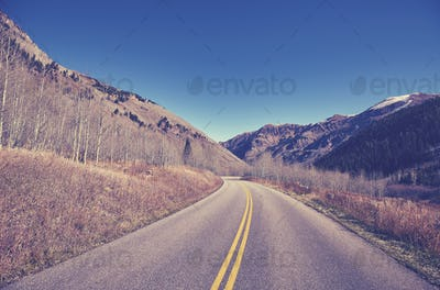 Vintage color toned scenic mountain road.