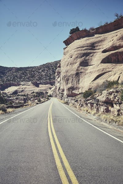 Retro toned scenic road, travel concept background, USA.