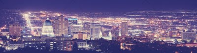 Vintage toned Salt Lake City downtown night panorama.