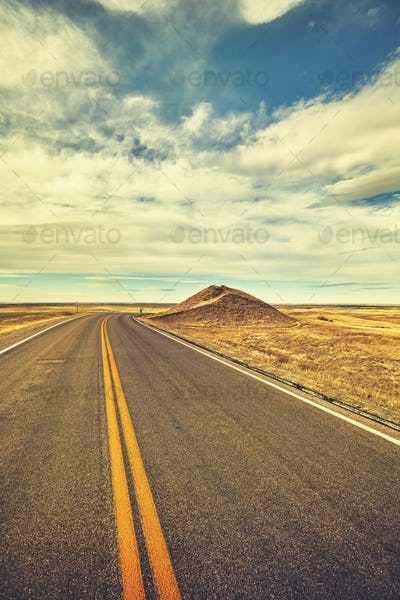 Vintage toned desert road, travel concept, USA.