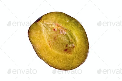 Cut plum on a white background