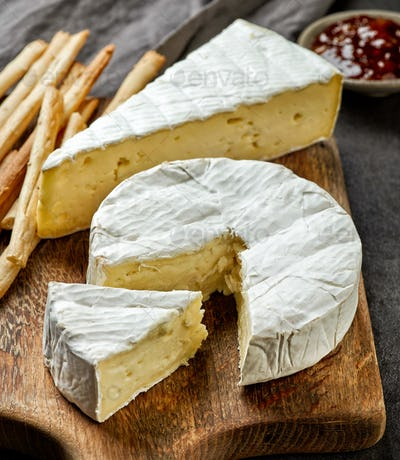 camembert cheese on wooden cutting board