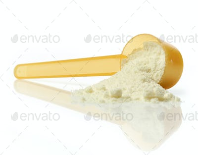 powdered milk in plastic spoon