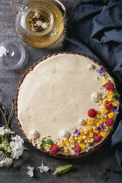 Chocolate tart with mango and raspberries