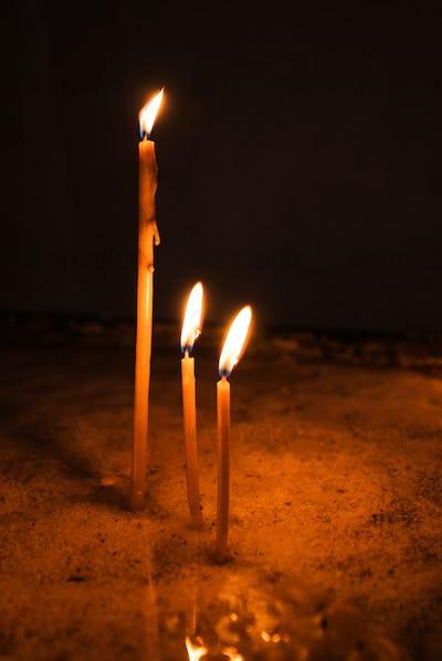 Wax church candles burning
