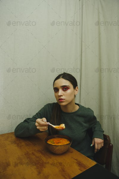 Vertical picture of calm woman eating