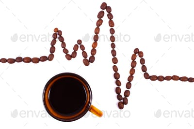 Cardiogram line of coffee grains and cup of coffee, medicine and healthcare concept