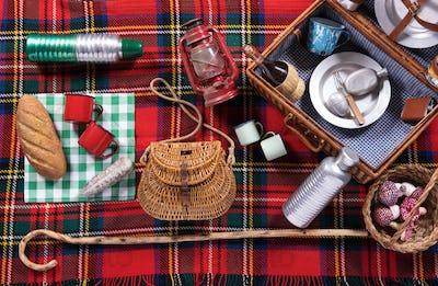Assortment of picnic tools on a tartan rug