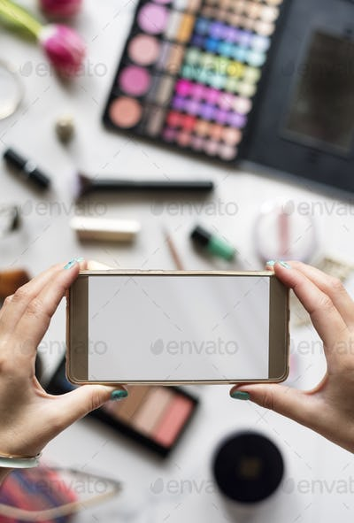 Woman Hands Using Mobile Phone Capture Photo with Cosmetics Back