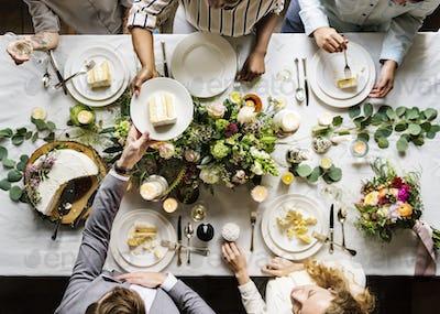 Groom Handing Cake to Friends on Wedding Reception