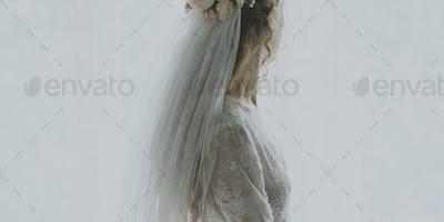 Woman in a wedding dress looking away