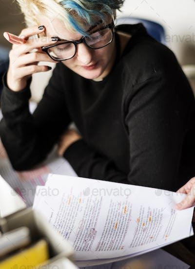 Stressed Woman with her Error Journal Paper