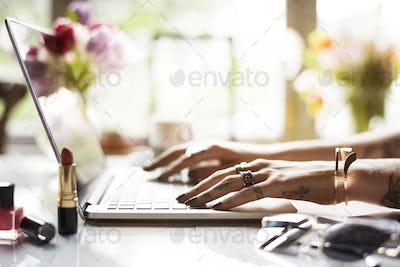 Woman Using Laptop Surfing Online Shop