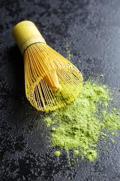 Green matcha tea powder and bamboo powder.