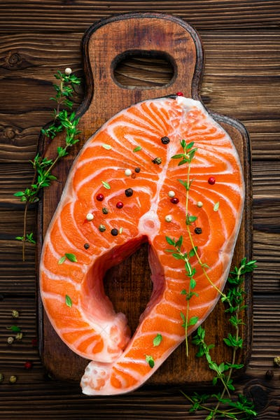 Salmon fish steak on wooden rustic background top view
