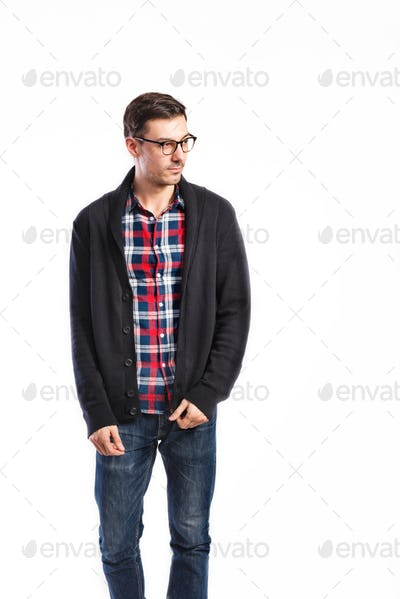Handsome man in checked shirt, studio shot, isolated
