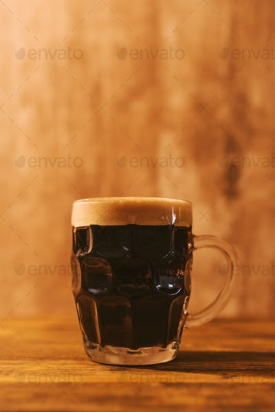 Dark beer in british dimpled glass pint mug