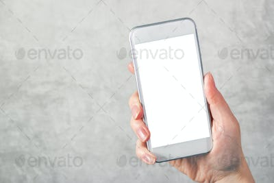 Female hand holding mobile phone with blank mock up screen