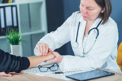 Female patient at orthopedic doctor medical exam for wrist injur