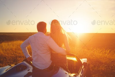 Happiness couple stay in the new sport car