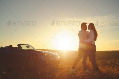Happiness couple stay near the new sport car