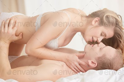 Couple petting on bed
