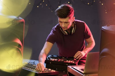 Passionate dj at turntable