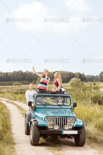 Friends driving village road