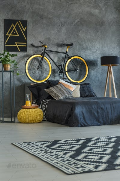 Grey student bedroom with bike