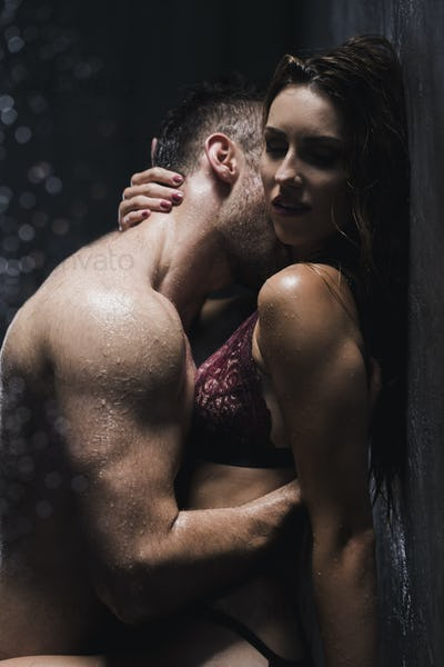 Woman in lingerie being kissed by a man