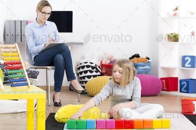 Psychologist observing little girl