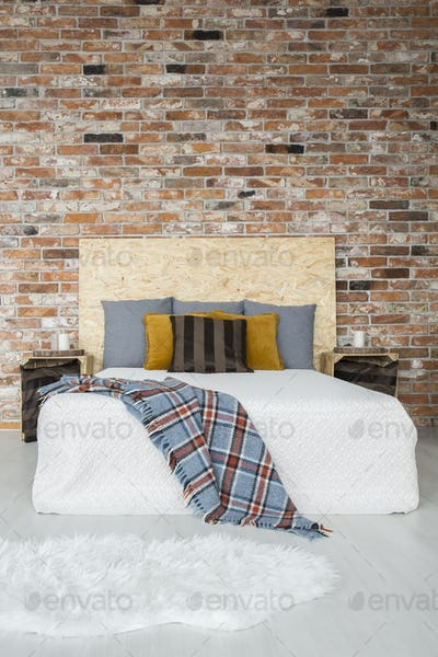 Industrial style bedroom with bed